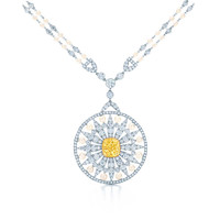 Tiffany & Co. - Medallion of pearls, white diamonds and a 3.60-carat Fancy Vivid Yellow diamond.