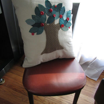 Teal Tree is a handmade, hand-appliqued, decorative throw pillow.