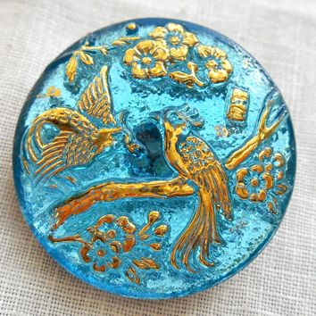 One Czech translucent aqua blue and gold glass peacock decorative shank button, 27mm, C02201