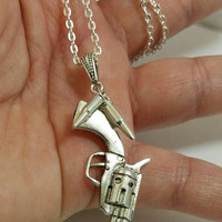 Bullet and gun pendant necklace with silver plated chain.