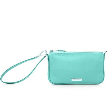 Tiffany & Co. -  Flat wristlet in Tiffany Blue® grain leather. More colors available.