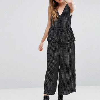 ASOS Jumpsuit in Spot with Peplum Ruffle Detail at asos.com