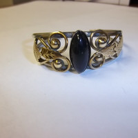 Silver Toned Handmade Bracelet with Gold Tone Leafs and Center Black Stone