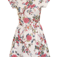 A cute white dress with an all over floral print. This dress has short cap sleeves, an ela