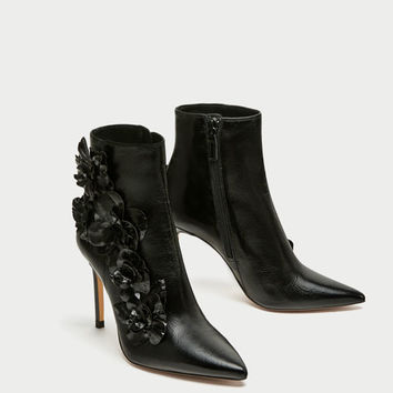 HIGH HEEL ANKLE BOOTS WITH FLORAL TRIMS DETAILS