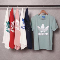 "Adidas ""do you like a multi colored sports T-shirt"