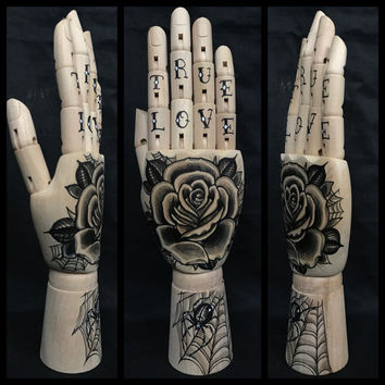 Wooden hand mannequin with original drawings of a rose and spider 'tattoo style'