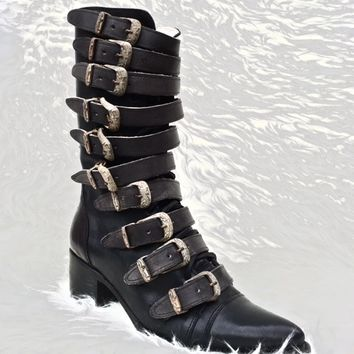 This edgy stack heel leather boot features pointy toe silhouette, multi buckle vintage-washed-leather straps construction with rustic antique finish hardware detailing, adjustable buckles accent. Finished with lightly padded insole, side zipper closure & l
