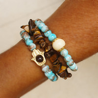 Blue beaded hamsa stretch bracelet, brown mother of pearl beads, set of 3
