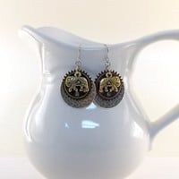 Earrings Hammered Silver, Antique Brass Gear and Gold Gita Elephant