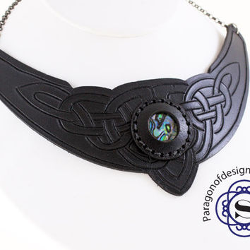 Hand carved black leather Celtic knot work necklace with abalone set in the centre.