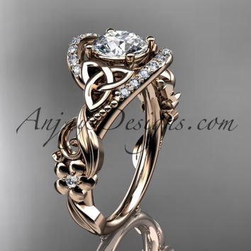 "14kt rose gold diamond celtic trinity knot wedding ring, engagement ring with a ""Forever One"" Moissanite center stone CT7211"
