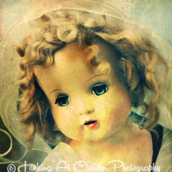 antique doll art photograph, beautiful old doll with a wistful gaze, vintage curly haired dolly, art photo