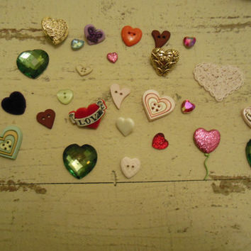 Assortment of heart shaped buttons, rhinestones and cabochons. 26 pieces total. Destash/Sewing/Crafts