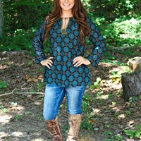 Our Glory Days Tunic Top by Natural Life is Black in color with Turquoise & Brown Medallions. This lightweight, 100% cotton, bracelet-length tunic features contrast tassel and block print design. Features an A-line Cut with a loose fit,