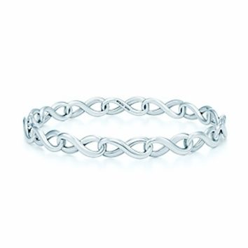 Tiffany & Co. -  Tiffany Infinity narrow bangle in sterling silver, medium.