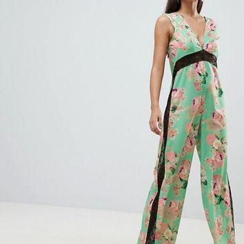 ASOS DESIGN jumpsuit with lace detail in soft floral print at asos.com