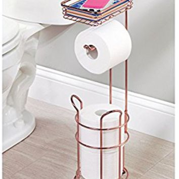 mDesign Freestanding Metal Wire Toilet Paper Roll Dispenser Holder and Extra Roll Reserve with Storage Shelf for Cell, Mobile Phone - Bathroom Storage Organization - Holds 3 Rolls - Rose Gold