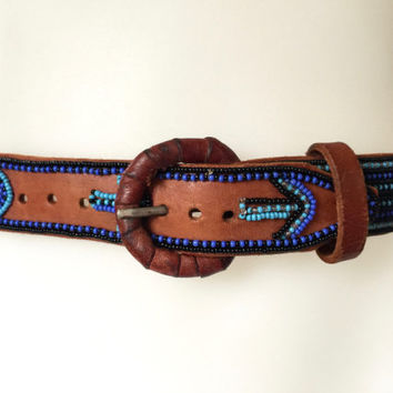 Vintage tribal tan leather belt with intricate geometric blue, turquoise black and clear glass hand beading