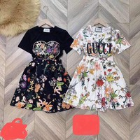 """Gucci"" Woman's Leisure  Fashion Letter Flower Printing Short Sleeve Long Skirt  Two-Piece Set Casual Wear"