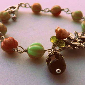 Garden  Inspired Bracelet,  Czech glass  Bracelet  Leaf and Flower Bracelet with Acorn Charm  Romantic Bracelet By Lyrisgems