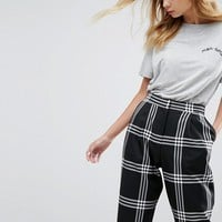 ASOS Tapered Mansy PANTS in Check at asos.com
