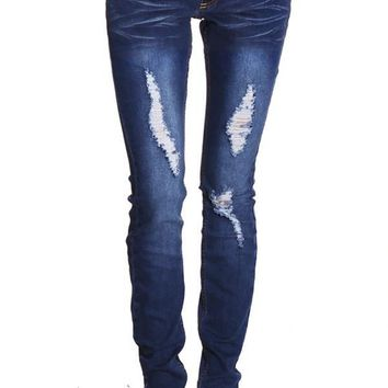 DISTRESSED JEANS WITH EMBROIDERED BACK POCKETS