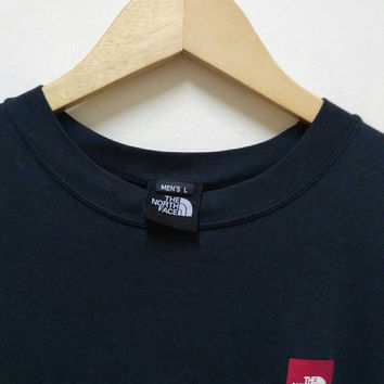 The North Face Tshirt black never stop exploring vintage