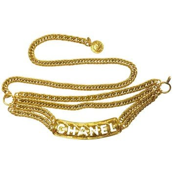 MINT. Vintage CHANEL golden three strand chain belt with quilted and logo motif.