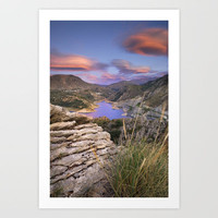 Clouds over the lake Art Print by Guido Montañés