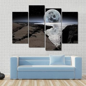 Cliffs And Coastline With Bright Moon In Night Sky Multi Panel Canvas Wall Art