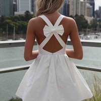 White Blessed Angel Dress Cross Bow Back from xeniaeboutique