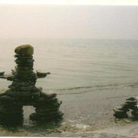 Pair of INUKSHUK on the shore looking out to sea on Blank Photo Note Card - I have passed this way