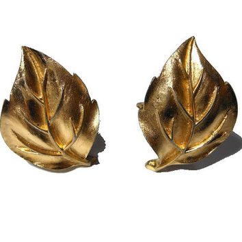 Crown Trifari earrings 1950s early 60s leaf gold clip earrings with textured sculpted veins.
