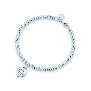 Tiffany & Co. - Return to Tiffany™ mini heart tag in sterling silver on a bead bracelet.