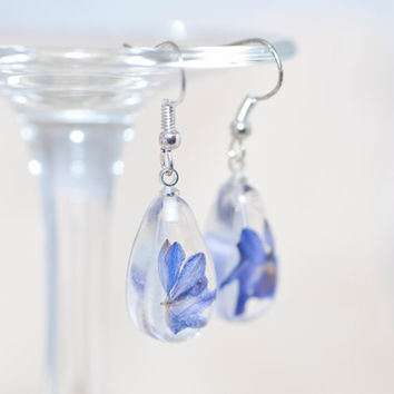 "Earrings ""Blue flower in a drop of resin"""