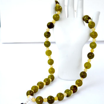 Faceted Jade Buddha Necklace. Buddah. Pendant. Green. Yellow. Jade. Bronze. Necklace. Jewelry. Religion. Culture. Faceted