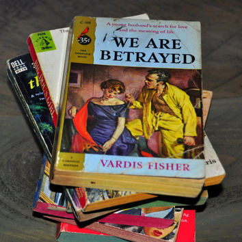 Vintage Romance Paperback Novel 1953. We Are Betrayed by Vardis Fisher. A Cardinal Edition C119.