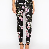 Ted Baker Skinny Pants in Mirrored Tropics Print at asos.com