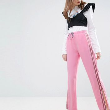 ASOS Woven Wide Leg Track Pants with Side Stripe at asos.com