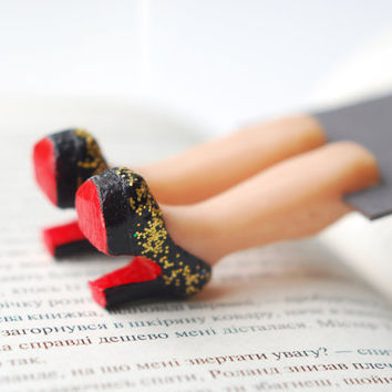Louboutin shoes bookmark with golden glitter. Legs in the book. Elegant fashion gift. Black , gold and red shoes.  oht summer
