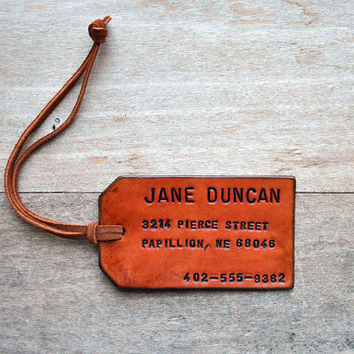 As seen in COUNTRY LIVING. Single Custom Leather Luggage Tag. Stamped with Your Name, address, and phone number.