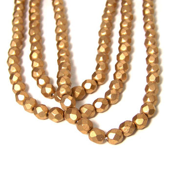 6mm Metallic gold glass beads, matte finish, faceted round, full strand (695G)