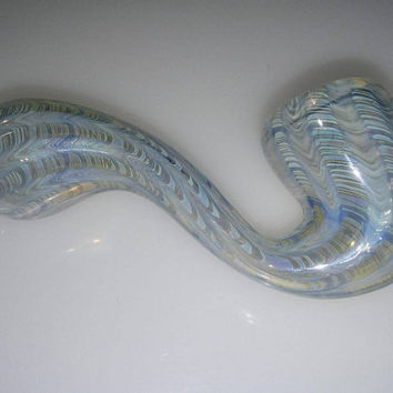 Hand blown glass , coloring changing, silver fumed, sherlock pipe. Blue colored, wrap and rake.