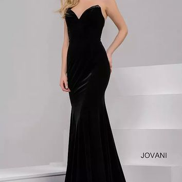 Black long fitted velvet strapless dress with plunging neckline.
