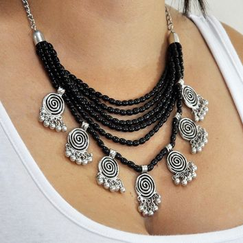 Anaba Statement Necklace Black Beads and Swirl Charms