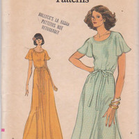 1970s vintage pattern for flared dress with butterfly sleeves knee or evening length misses size 14 Vogue 9430 UNCUT