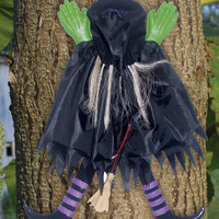 halloween decorations: tree trunk witch assorted