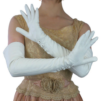 White, Opera Length, 12-button Leather Gloves with 3 Buttons at the Wrist, Lined in Silk.  (NSP)