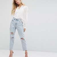 ASOS RECYCLED ORIGINAL MOM Jeans in Radleigh Light Wash with Rips and Busts at asos.com